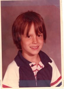 Poor, bad hair, and meat stuck in my throat…..this was 2nd grade for me.