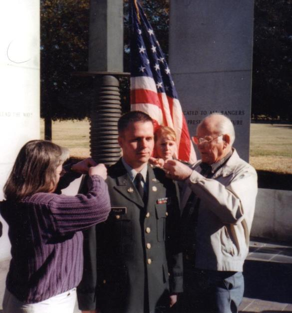 "My ""grandpa"" is a WWII veteran and pinned on my lieutenant bars at Ft. Benning in Jan 2003. He's not really my grandpa but that's what I call him."