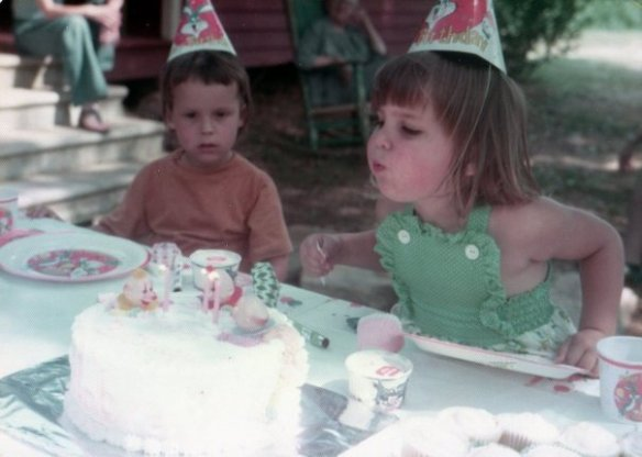 At my cousin's birthday party. I look mesmerized by the cake. Nice haircut, too.